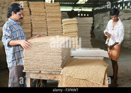 Men working in coir factory ; Alappuzha ; Kerala ; India NO MR - Stock Photo