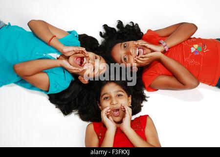 Teenage girls lying down and shouting MR# 761 - Stock Photo