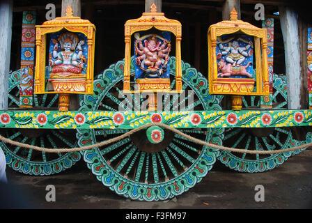 Statues carved on wheel of Rath yatra car festival ; Puri ; Orissa ; India - Stock Photo
