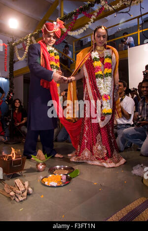 Indian bride and bridegroom holding hand taking round around holy fire in marriage ceremony MR Bride#729E;NO MR - Stock Photo
