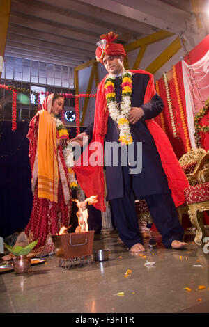 Indian bride and bridegroom holding hand taking round around holy fire in marriage ceremony MR Bridegroom#729E;NO - Stock Photo