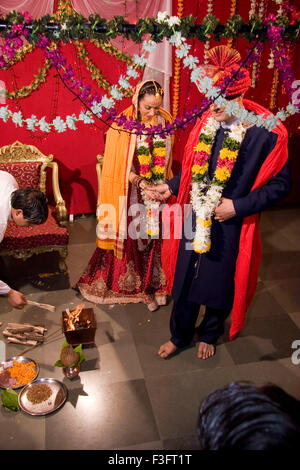 Indian bride and bridegroom holding hand taking round around holy fire in marriage ceremony MR Bridegroom#729E; - Stock Photo