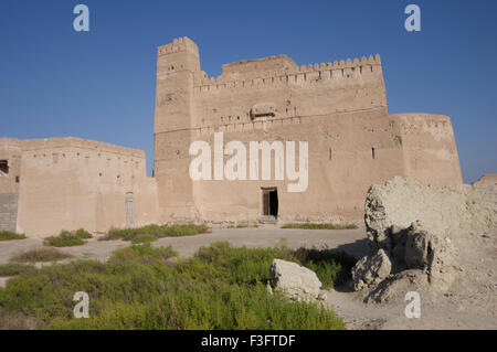 Ornate ancient adobe fortress in a town in the Sultanate of Oman, a safe, friendly Gulf State holiday destination - Stock Photo