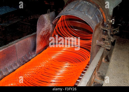 Red hot steel wire rod making in factory ; India - Stock Photo