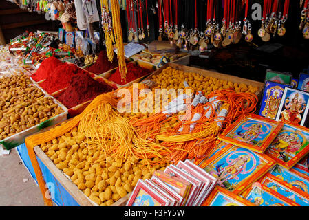 Turmeric and gods pictures in shop ; Swamimalai ; Tamil Nadu ; India - Stock Photo