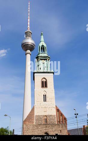 Berlin Fernsehturm TV Tower next to St Mary's Church, Berlin - Stock Photo