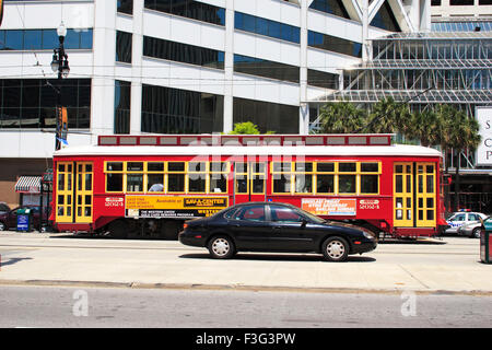 A private car and public transportation ; canal street ; New Orleans ; Louisiana ; U.S.A. United States of America - Stock Photo