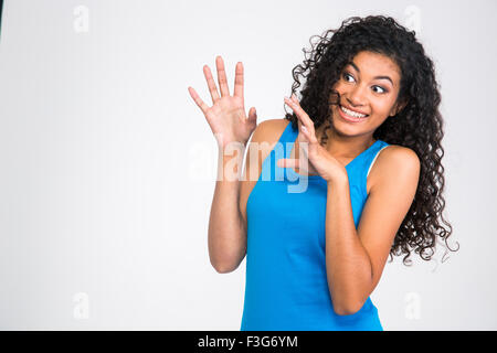 Portrait of a frightened afro american woman standing isolated on a white background - Stock Photo