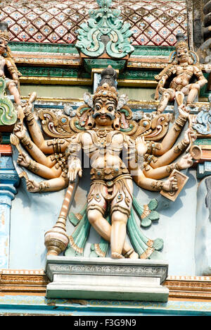 Richly decorated colourfully painted stucco figure west gopuram of Shree Meenakshi Sundareswarar temple ; Madurai - Stock Photo