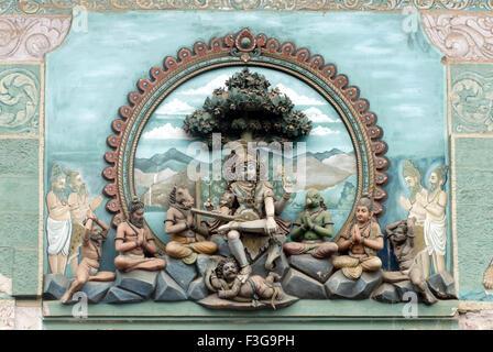 Painted figures of mythological deities on South gopuram at Shree Meenakshi Sundareswarar temple ; Madurai ; Tamil - Stock Photo
