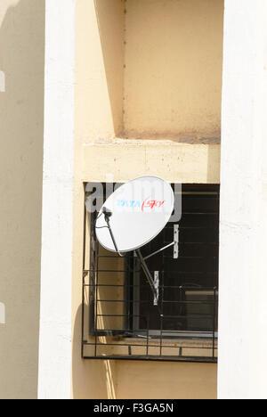 Dish Antenna of TATA Sky fixed to window grill ; Borivali ; Bombay Mumbai ; Maharashtra ; India - Stock Photo