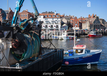 Heavy lifting gear on a fishing trawler berthed alongside Endeavour Wharf, Whitby, North Yorkshire, England, UK - Stock Photo