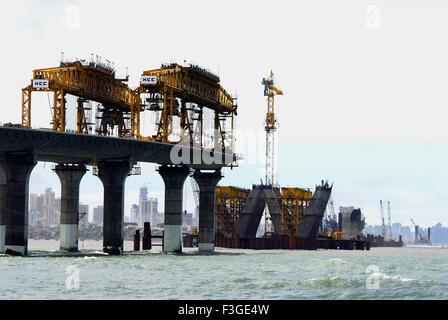 Progress in Under Construction Work Bandra Sea link ; Photo taken from Mahim Creek Bombay Mumbai ; Maharashtra - Stock Photo