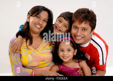 Indian family parents with children husband wife son daughter portrait white background - MR#364 - RMM 123326 - Stock Photo