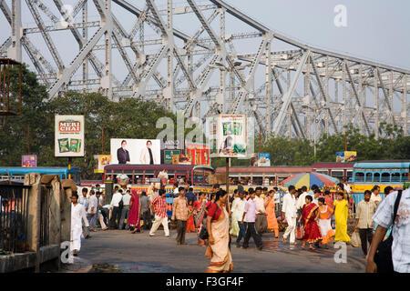 Street Scene ; Howrah Bridge now Rabindra Setu over River Hooghly ; Calcutta Kolkata ; West Bengal ; India - Stock Photo