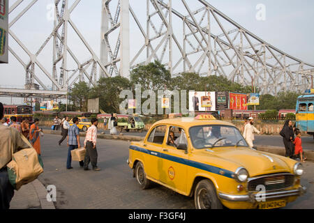 Street transportation ; Howrah Bridge now Rabindra Setu over River Hooghly ; Calcutta Kolkata ; West Bengal ; India - Stock Photo