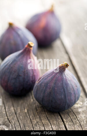 fresh figs on kitchen table - Stock Photo
