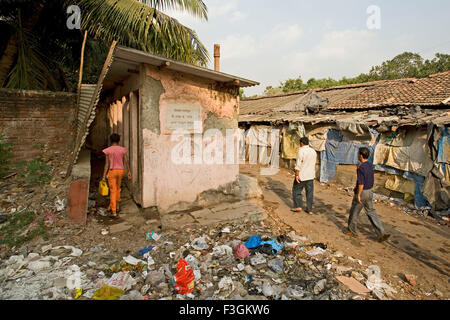 Public toilets for gents in a slum in unhygienic condition ; slum Khotwadi ; Santacruz ; Bombay now Mumbai ; Maharashtra - Stock Photo
