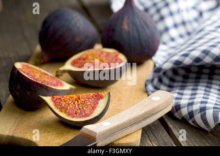 sliced fresh figs on cutting board - Stock Photo