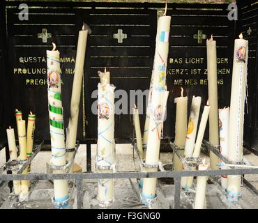 Candles at Lourdes, Shrine and Sanctuary in the Hautes-Pyrénées - Stock Photo