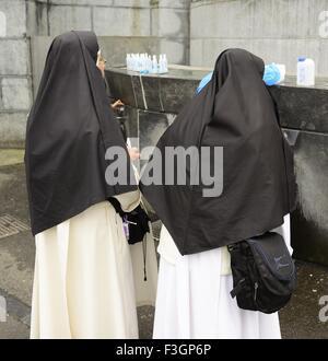 Nuns at Lourdes, Shrine and Sanctuary in the Hautes-Pyrénées - Stock Photo