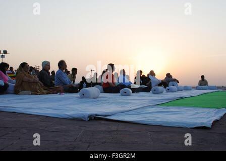 Tourists enjoying morning concert during Marwar festival ; Jodhpur ; Rajasthan ; India - Stock Photo