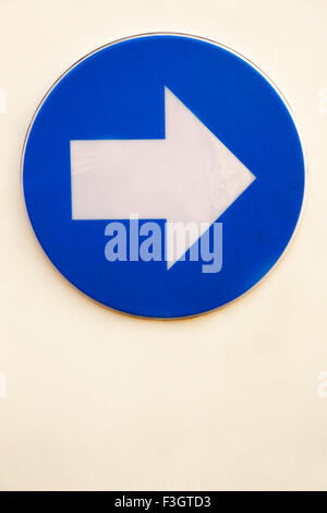 Sign of arrow indicating direction to right in blue and white color ; Pune ; Maharashtra ; India - Stock Photo