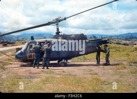 US army soldiers look at Bravo Troop, 1st Squadron, 9th Cavalry, 1st Cavalry Division helicopter gunship crashed. - Stock Photo