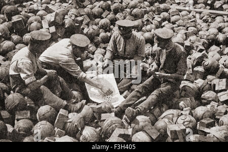 British soldiers, sat on captured German equipment, playing a game of cards during WWI. - Stock Photo