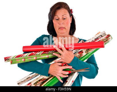 A woman discovered she has too many Rolls of Christmas wrapping paper to Carry - Stock Photo