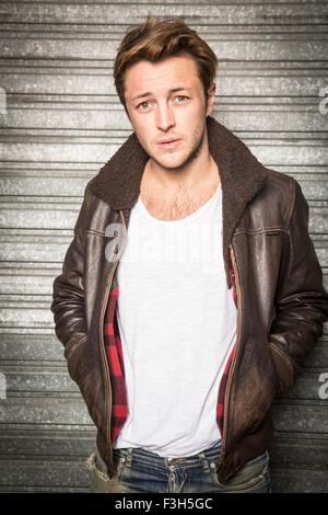 Portrait of young man, wearing leather jacket - Stock Photo
