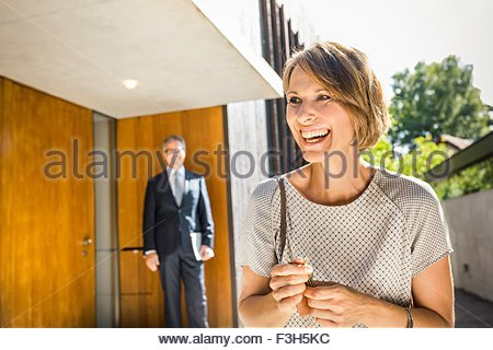 Mature woman with keys for new house - Stock Photo
