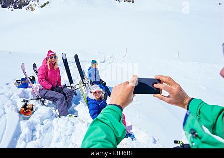 Family taking photograph on ski trip, Chamonix, France - Stock Photo