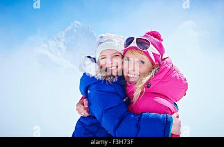 Mother and daughter hugging, Chamonix, France - Stock Photo