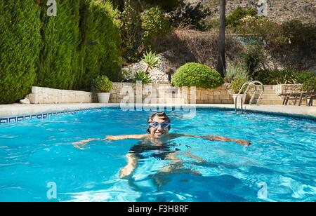 Portrait of young man in swimming pool - Stock Photo
