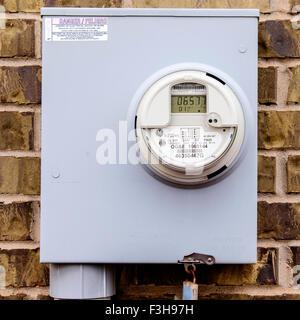 A closeup image of an electric meter in Oklahoma City, Oklahoma, USA. - Stock Photo
