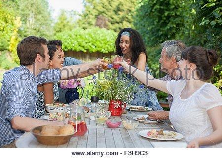 Family enjoying meal, outdoors - Stock Photo