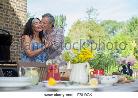 Senior couple embracing outdoors - Stock Photo