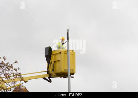 Man In Cherry Picker Painting The Hull Of A Fishing Vessel