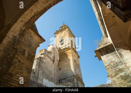 Low angle arch view of tower of Medina Sidonia church, Andalucia, Spain - Stock Photo