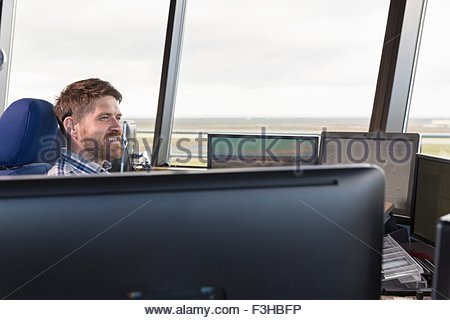 Man at work in air traffic control tower - Stock Photo