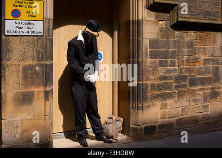 EDINBURGH, SCOTLAND - JUNE 11, 2015: Living statue street artist dressed as invisible man performing in Old Town - Stock Photo