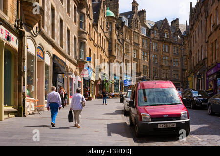 EDINBURGH, SCOTLAND - JUNE 11, 2015: Cockburn street in Old Town with many shops and cafes. A historical and touristic - Stock Photo
