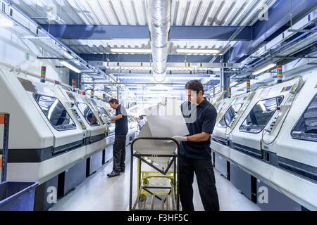 Workers in circuit board manufacturing factory - Stock Photo