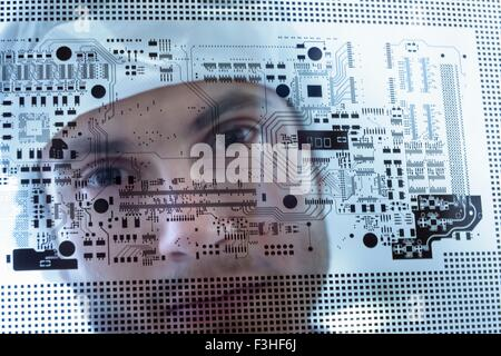 Worker inspecting circuit board negative sheet in circuit board factory, close up - Stock Photo