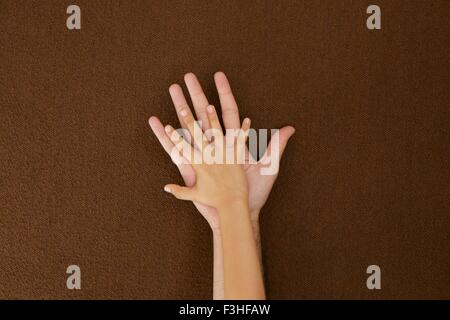 Child's and man's hands on each other - Stock Photo