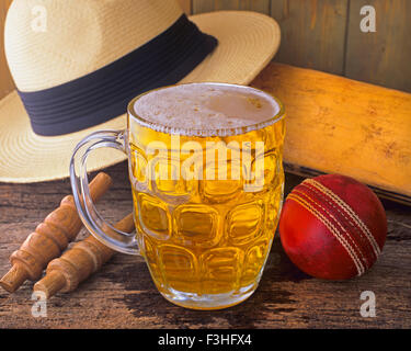 After a cricket match at the village pub on summer afternoon - Stock Photo