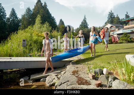 Friends going canoeing in lake, Seattle, Washington, USA - Stock Photo