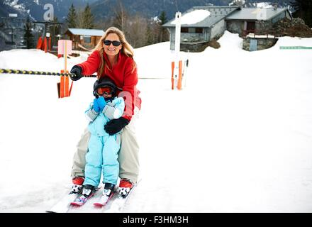Male toddler in front of mother moving up on ski rope, Les Arcs,Villaroger,Savoie,France - Stock Photo