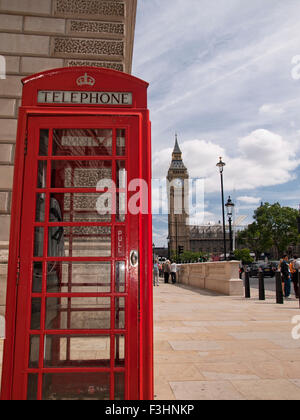 Typical red telephone box with Big Ben in the background in London. England. Great Britain. - Stock Photo